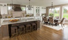 A beautiful open kitchen and dining area in a home by Cincinnati custom builder Zicka Homes. Open Kitchen, Kitchen Dining, Kitchen Cabinets, Kitchen Utensils Store, Home Trends, Small Appliances, Woodworking Tips, Cincinnati, Dining Area