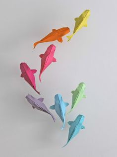 Colored Koi paper installation by Sipho Mabona http://www.etsy.com/people/MABONAORIGAMI #paper_sculptures #art