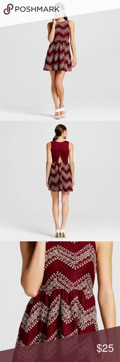 Burgundy and beige dress New with tags adorable sleeveless dress with peephole in the back. Cinched elastic at the waist. Crochet-like thread embroidery. Size XXL or 14-16 in dress sizes. Great to be worn for a night out or even professionally with a nice blazer or sweater on top. 100% polyester with attached lining. Any questions please ask! Xhilaration Dresses Mini