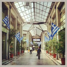 Pesmatzoglou Stoa that runs through the New Arsakeio building is one of the most beautiful commercial spots in Athens. Attica Greece, Athens Greece, Zorba The Greek, Neoclassical, Store Design, Places Ive Been, Places To Visit, Commercial, University