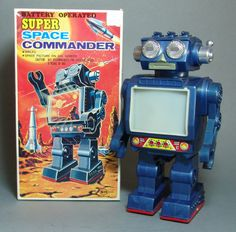 This battery operated Space Commander Robot was made in Japan by Horikawa and is circa the 1960's. Works perfectly – walks with revolving, lighted space scene in chest. In old stock condition with all