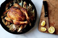 A perfectly browned bird and a mess of sweet, golden veggies. Skillet Roast Chicken with Fennel, Parsnips, and Scallions recipe