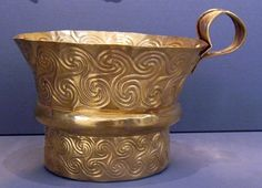 Gold cup decorated with spirals executed in repousee from Grave 5 of Grave Circle A at Mycenae. Height 5 inches.@ Visit users.stlcc.edu