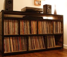 this is what i need. record shelves with a space for a record player/tv on top