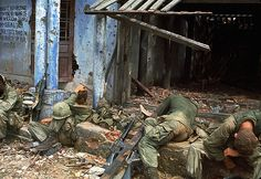 13 Mar 1968, Quang Tri --- Exhausted GI's Rest in Front of a Ruin. Vietnam War (V)