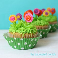 royal icing flowers on grassy cupcakes