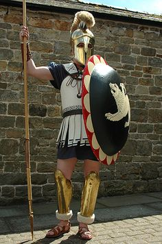 A hoplite of the Greek style. In earliest Roman history soldiers fought in much the same equipment Greek warriors used. Of the five classes defined the in the census, the first class was made up of those wealthy citizens who possessed the best armament. This excellently equipped hoplite would therefore no doubt be of the first class.