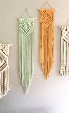 Mint & Mustard Long Macrame Wall Hanging This mint and mustard color macrame wall hanging combo brings bright color and energy to your space. Looking to remodel or redecorate? Add this easy diy piece to your home decor macrame wall hanging easy Macrame Design, Macrame Art, Macrame Projects, Macrame Knots, Macrame Mirror, Macrame Wall Hanging Patterns, Macrame Patterns, Woven Wall Hanging, Diy Décoration