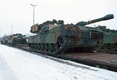 M1A2 Abrams tanks arrive at the Grafenwoehr railhead, Jan. 31, 2014. U.S. Army Europe will soon dispatch a survey team into eastern Europe to scout potential locations for tanks and other military hardware in connection with a broader effort to bolster the U.S. military presence in a region rattled by Russia's intervention in Ukraine, the Army's top commander in Europe Lt. Gen. Ben Hodges, said Friday, Jan. 23, 2015. MICHAEL DARNELL/STARS AND STRIPES