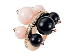 Cartier ring from the Évasions Joaillières Collection in pink gold, set with pink opals, onyx and diamonds.
