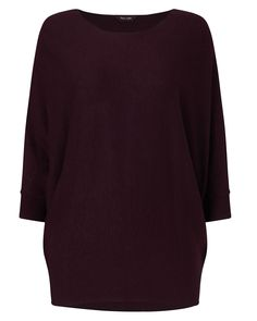 21a62f4c4eb675 A loose-fitting soft knitted jumper with a slash neckline and batwing  sleeves with ribbed cuffs.