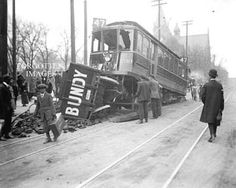 Trolley car crashed into a coal truck, circa 1910.