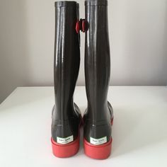 Previously loved Authentic Kate Spade Rain Boots Brown and pink Authentic Kate Spade tall rain boots. Only worn a handful of times.  Size 6 but fits like a 6.5. kate spade Shoes Winter & Rain Boots