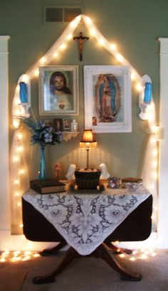 My 2013 Catholic home altar. The picture is a bit fuzzy, so sorry about that. The basket in the middle has my Baby Jesus bought in Mexico in about 1977. #HomeAltar