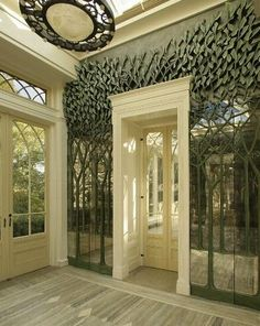 "Sculpted forest framing the entrance. I'd do an entire room similar to this with an entire forest theme, moss-look carpeting, plus pillows that look like stones, ivy, etc. Perhaps a lighted ceiling with LED's for stars when the ""day"" lights are off. Cool."