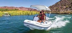 """Try out the self driving """"Rubba Duck Tours"""" in Lake Havasu City today! Drive your own personal mini boat as you tour some of the most popular and historical spots on the lake! Boat Bimini Top, Duck Tour, Lake Havasu City, Racing Events, Boat Accessories, Self Driving, Boater, Rock Climbing, Kayaking"""
