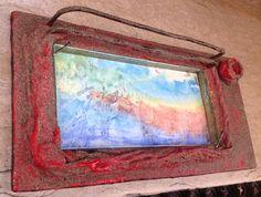 Immagine frutto della fantasia di una bimba di 3 anni. Cornice di legno, cartapeste, fil di ferro arruginito e vetro da mm 8