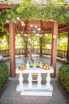 Outdoor wedding, with bouquets for the mothers and sand ceremony vessels