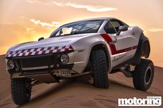 Rally Fighter in Dubai - I want it! Satin black with aeronautic style striping... *homer drool*