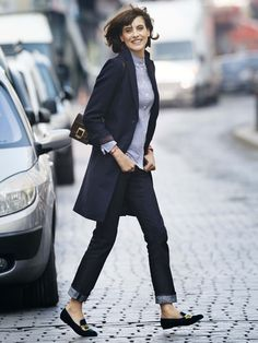 I like the straight, dark blue, cuffed jeans and the nice flats with the long cardigan or is that a coat?