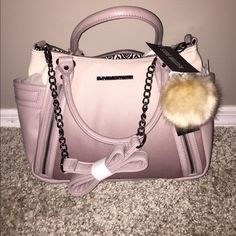 Steve Madden Ombré Satchel ⭐️NWT⭐️ Steve Madden Taupe Ombré Satchel ❤️ Amazing looking bag❣ Long strap included This bag is awesome  ⭐️Nickle color chain accents ⭐️Pom not included if you would like to purchase I can add $15 to the listing so please let me know beforehand Steve Madden Bags Satchels