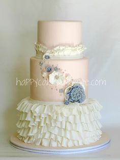 """""""Ruffled cake - love the broach and flowers"""""""