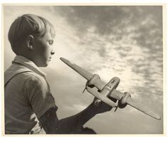 Boy with his toy plane, ca. 1930s