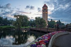 This is where I live!  Stunning Riverfront Park in the heart of Spokane through the lens of James Richman.  #Spokane #prettycity #flowers #rivercity #clocktower