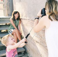 """""""Working mom problems."""" A big shout out to all those Mom Photographers out there! @jessbarfield, we couldn't help but smile when we saw this photo! You're a Supermom, keep at it!   #fotospotting #Fotostrap"""