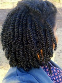 Thick two strand twists. To learn how to grow your hair longer click here - http://blackhair.cc/1jSY2ux