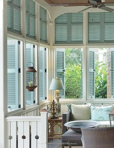 Sunroom with light blue shutters and white woodwork⭐