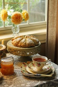 Tea Time. Scones, apricot preserves, and a lovely cup of tea. This looks so warm and inviting.