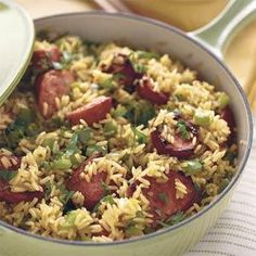Skillet Sausage 'n' Rice - Easy One-Dish Dinners - Southern Living - Make this rice and smoked sausage main dish recipe all in one skillet for an easy weeknight meal with very little cleanup. Recipe: Skillet Sausage 'n' Rice Sausage Recipes, Pork Recipes, Cooking Recipes, Easy Recipes, Cooking Rice, Delicious Recipes, Healthy Recipes, Vegetarian Recipes, Vegetarian Breakfast