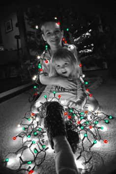 "Michelle Herring's kids Levi, 8, and May, 3, pose for a holiday photo at their home in Roswell. ""This was right before we hung the lights on the tree – we decided to hang the lights on them first,"" Herring says."