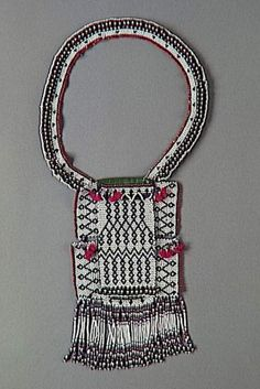 South Africa | Necklace; costume element of a young uninitiated man | Cotton, leather, wool, glass beads | Nguni / Thembu / Xhosa people Bead Jewelry, Tribal Jewelry, Africa Necklace, Xhosa, African Trade Beads, African Textiles, Letter Beads, Religious Jewelry, Necklace Types
