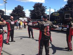 Stretch! Furniture Row Racing crew in their pre-race warm up at Watkins Glen. #NASCAR