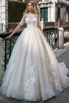 Alluring Tulle Jewel Neckline Ball Gown Wedding Dress With Lace Appliques & Beadings