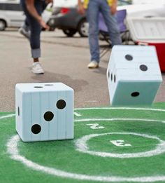 Diced Darts Outdoor Maths Game- throw dice onto 'dart board', add/subtract/multiply the dice number and the dart boar ring number.