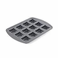 """Brownie Pan - $19.00    Perfect for """"corner-piece"""" lovers! Make individual brownies, cornbread, mini appetizer pizzas and more. Aluminized steel ensures excellent heat distribution. You can keep a secure grip on the extended edges, then count on easy release and quick cleanup thanks to the nonstick coating. 12 individual ¼-cup wells, 2 ½"""" x 2½"""" x 1"""" each."""