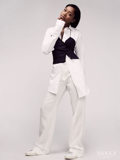 Keke Palmer wears Jacquemus La Mini Robe Chemise, $470, jacquems.com. DKNY Wide Leg Pants, $255, dkny.com. Common Projects Original Achilles Low in White, $411, creaturesofcomfort.com. Keke's Own Necklace. Photography by Nyra Lang for Yahoo Style.