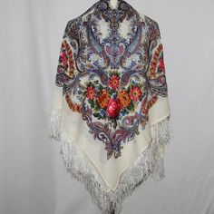 """Russian Pavlov Posad Woolen Shawl Silk Fringe by Ushanka-hat. $94.99. Among unique, world-wide known products, presenting pride and glory of Russia, a particular place occupy shawls from an ancient town of Pavlovsky Posad  Every year """"Pavlovo Posad Shawl Manufactory"""" issues around 300 kinds of shawls, kerchiefs, scarves, cache-nez, tablecloths of natural fibers: wool, cotton, silk. Recognition of a high art and cultural value of our products is the fact that to the f..."""