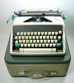 Olympia  Manual Portable Typewriter with Owners by joevintage, $285.00