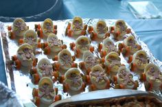 This was an idea i got off of youtube, just type in baby carriage devil eggs, the women who shows you how to do this is awesome, she has a web site of other idea's for different things:) the only thing i did different then her and it was really by accident because i forgot the poppy seeds for the mouth so i  had to improvise, i used pink and blue jimmies and it looked like little pacifiers:) so i figured i would share the idea with everybody:)