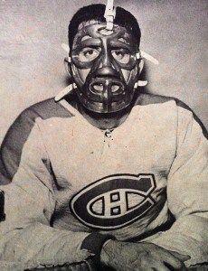 Cesare Maniago, displaying the mask former Ranger goalie Jacques Plante designed for him.