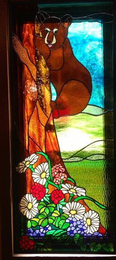 Lower window on a tall narrow stairwell. The daisy petals are actually yellow.  This piece looks good by itself, however the second window above it is a continuation of the scene.