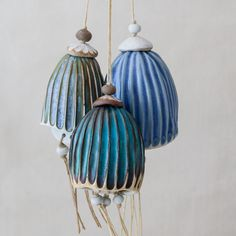 each bluebell is hand formed and hand carved of porcelain and glazed in subtle shades of blues and turquoise