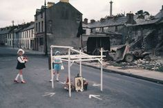 Northern Ireland, 1970s. Japanese photographer Akihiko Okamura first travelled to Northern Ireland in 1968 with a view to tracing John F Kennedy's family history but he soon committed himself to focusing on The Troubles. Working in colour, his pictures capture the everyday lives of those living in the midst of the conflict