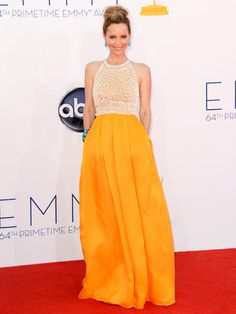 Cute as a button, #LeslieMann sports an effortless #topknot and youthful crocheted yellow dress. #Emmys2012 #BestDressed2012