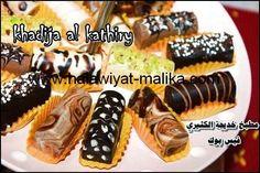 شوكولاتة راقية بحشوة البسكويت للأخت خديجة الطريقة بالصور في الرابط: http://www.halawiyat-malika.com/2014/07/blog-post_17.html