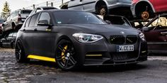 Manhart Racing tunes up the BMW to a total power output of 400 horsepower. This car was unveiled at this year's Essen Motor Show. Bmw 116i, Bmw M5, Bmw M Power, 135i, Black Bullet, Performance Tyres, Bmw 1 Series, Bmw Love, Latest Cars